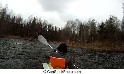 Rafting on a kayak spring river - Shot from the rear...