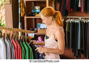 Red woman shopping - Red young beautiful woman shopping in...