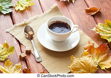 autumn stillife - Cup of coffee and piece of sugar