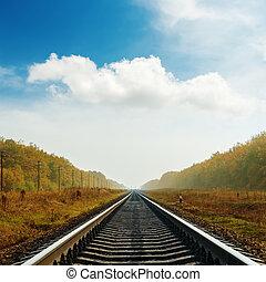 railroad to horizon in autumn