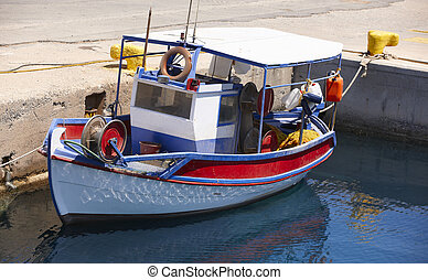 Fishing boat at Kissamos port in Crete. Greece. Horizontal