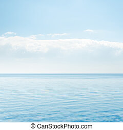 light cloud over blue sea