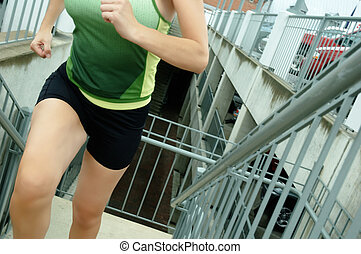 Urban Runner - Mature woman runner in the city