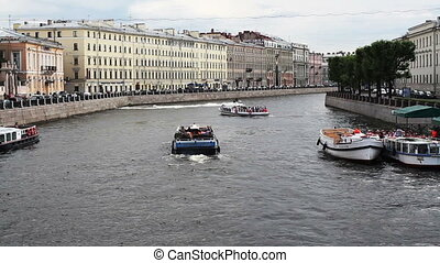 River channel with boats in Saint-P - St.Petersburg , Russia...