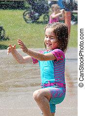 Child playing at the water park