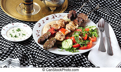 Mixed shish kebab - Grilled meat and chicken beets with...
