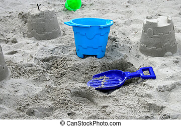 Bucket and Spade - Blue bucket and spade on the sand with...