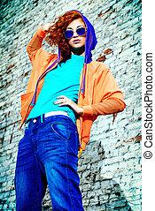 youth trend - Young stylish girl in the city Brick wall...