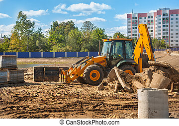 construction machinery - tractor mover on building site