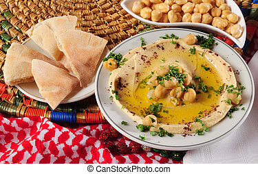 Hummus - Mashed chickpeas with olive oil and pita bread on...