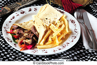 Shawarma - Stuffed pita bread with beets of meat