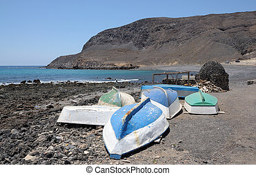 Rowboats on the beach of Pozo Negro, Canary Island Fuerteventura, Spain