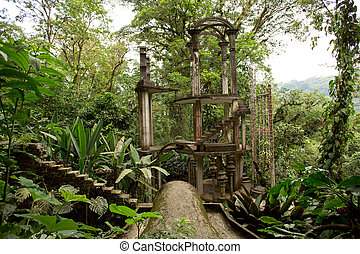 concrete structure with stairs surrounded by jungle -...