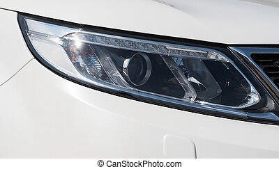 car head lights in silver - closeup