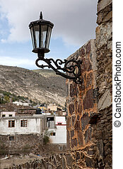 old street light - old wrought iron street light bolted to...