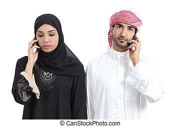 Arab couple disgusted on the phone isolated on a white...