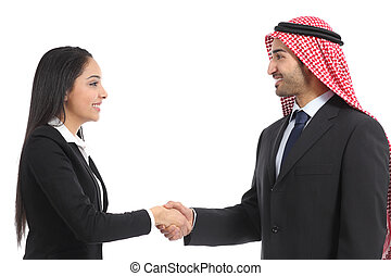Side view of an arab saudi businesspeople handshaking...
