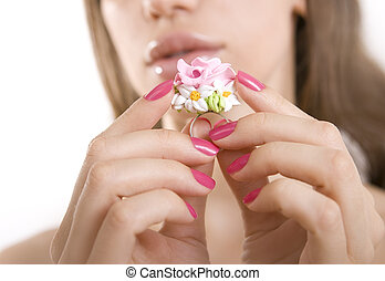 Fashion studio shot of beautiful woman with a floral ring...