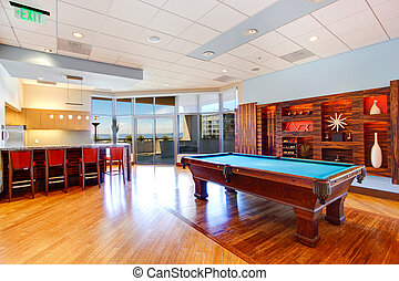 Entertainment room with pool table and walkout deck
