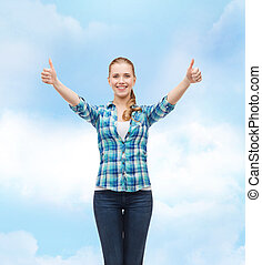 smiling girl in casual clothes showing thumbs up - happiness...
