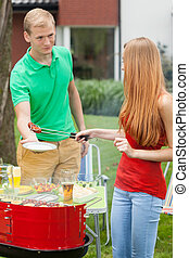 Couple on a barbecue
