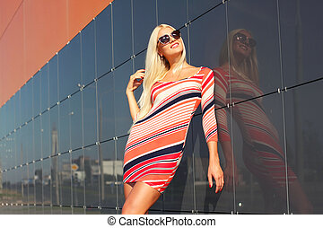 beautiful attractive trendy girl with sunglasses posing on...