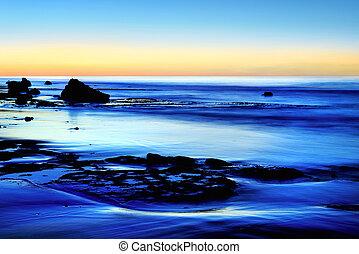 Dusk at the blue sea