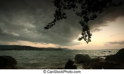 Evening rocky beach on a cloudy day. Thailand