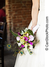 Bride holding wedding bouquet - Bride holding beautiful...