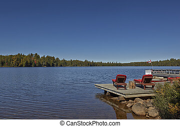 Wooden chairs overlooking a lake