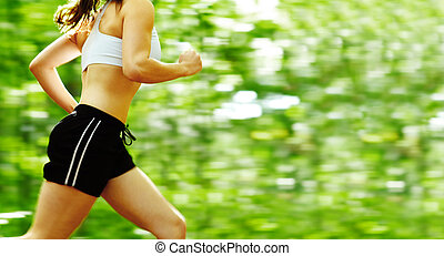 Forest Runner - Beautiful young woman runner in a green...