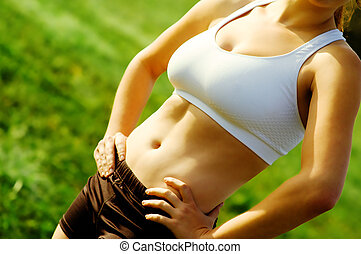 Woman\'s Abs - Close up view of beautiful womans abdomial...