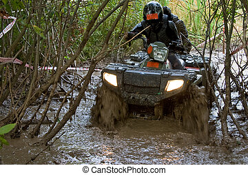 Crossing the dirt river - Sportsman riding quad bike at...