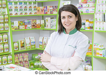 Drugstore - Young female pharmacist in a drugstore