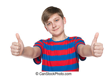 Teenager boy holds his thumbs up