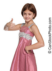 Pretty preteen girl holds her thumb up - A pretty preteen...