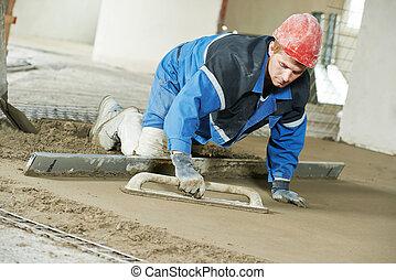 Plasterer concrete worker at floor work - Plasterer at...