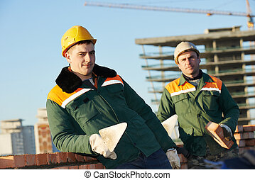 construction mason worker bricklayers - two construction...