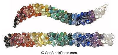 Chakra Healing Crystals - Multi colored chakra crystals in...