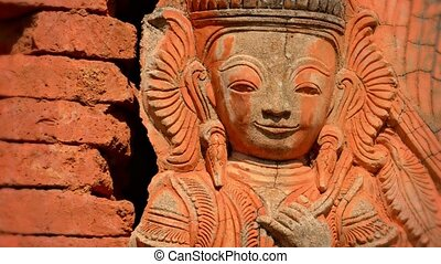 Ancient red stone statue Burma, Inle Lake - Video UHD -...