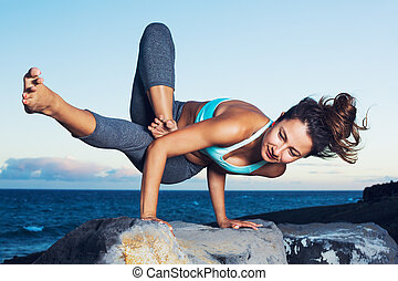 Yoga Woman - Athletic strong woman practicing difficult yoga...