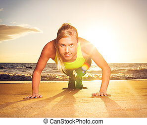Fitness woman doing push ups