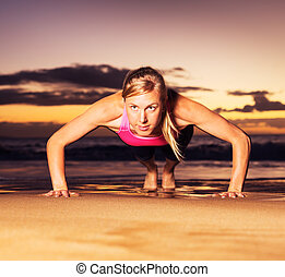Fitness woman doing push ups - Fitness young woman doing...