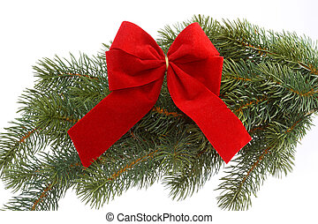 Red gift ribbon on fir tree branch on a white background....