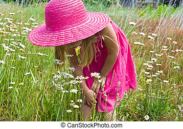 Stop And Smell - Little girl stopping to smell the wild...