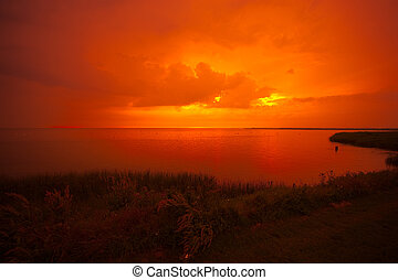 beautiful sunset at a lake IJsselmeer in the netherlands