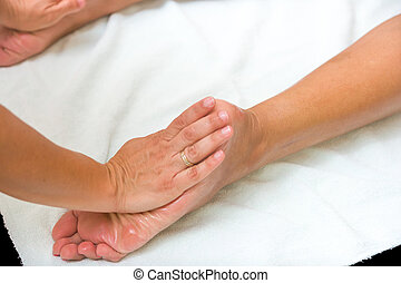 Man receiving professional foot massage.