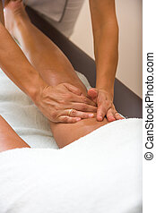 Man receiving professional foot massage - Man receiving...