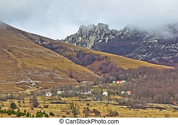 Velebit mountain village in fog, Daske ostarije, Croatia
