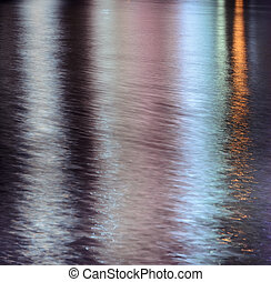 Cit lights reflection on the water - Colorful lights...